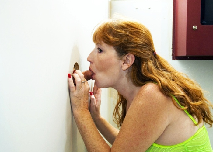 Redhead Wife enjoys a Gloryhole BJ